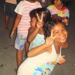 Thai children playing in the street , Phuket, Thailand