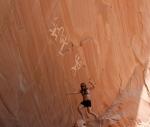 Sonja Nash under Anasazi Petroglyphs