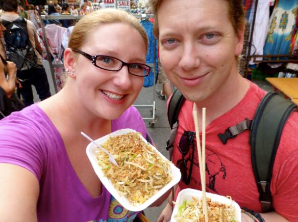 Travelers Enjoying Thai Street Food